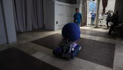 Robots play game with a large ball Stock Footage
