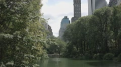 Central Park Pond with Skyscrapers in Background Stock Footage