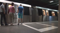 Weekend days relaxed transport in town few people empty subway train doors close - stock footage