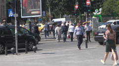 Action outdoors, people move on crosswalk, daily routine for commuters stepping  Stock Footage
