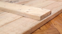 Carpenter nailing planks - stock footage