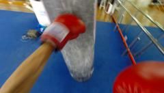 POV Heavy bag / Punching bag work with gloves, slow motion Stock Footage