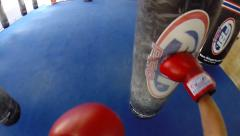 POV Heavy bag / Punching bag work with gloves, slow motion, 720p - stock footage