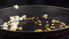 Popcorn popping on black background, Slow Motion Stock Footage