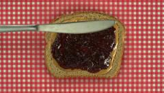 Spreading peanut butter and jelly on bread, Slow Motion - stock footage