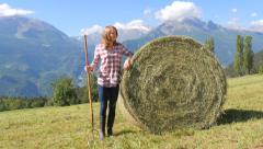 Beautiful farm girl with pitchfork Stock Footage