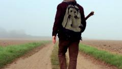 Traveler walks away into the mist. Part of my Journey Collection Stock Footage