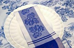 blue and white dinner napkin - stock photo
