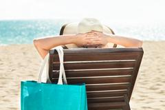 Woman relaxing on deck chair Stock Photos