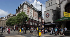 UHD 4K Leicester Square Underground Station Charing Cross Road People London UK Stock Footage