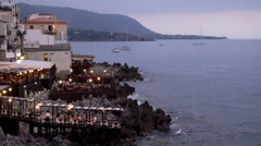 Evening restaurants on the seafront at Cefalù, Sicily Stock Footage
