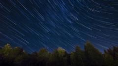 Night sky timelapse star trails comet effect Stock Footage