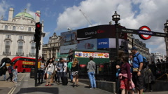 People Commuting Underground Station Exit Piccadilly Circus London Landmark DOOH Stock Footage