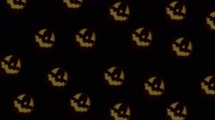 Army of Jack-o'-lanterns rolling on the black background Stock Footage