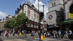 Leicester Square Underground Station Charing Cross Road Traffic People London UK Stock Footage