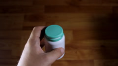 Man Hands Pouring A Bottle Full With Pills In His Hand, Medical, Drugs, POV Stock Footage