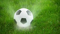Soccer ball spinning on the field with rays of light Stock Footage