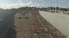 Runners row run into the Ijtunnel during the Damloop in Amsterdam Stock Footage
