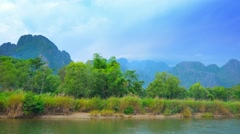Coast of the small river and mountains in the background. laos, vang vieng Stock Footage