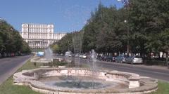 Water fountain, get wet, huge boulevard in summer season, Parliament background Stock Footage