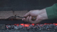 Red embers under grill, meat food cooked on direct fire, man love barbecue meal Stock Footage