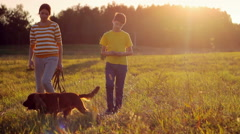 Children with brown dog in nature, sunset, together, calm atmosphere - stock footage