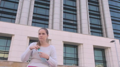 Corporation landscape, thirsty blonde woman drinking water from plastic bottle Stock Footage
