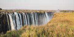 Panoramic view of Victoria Falls with toruists in Zimbabwe Stock Photos