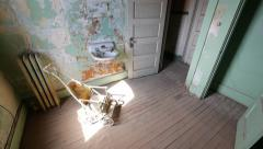 Haunted Room with Scary Antique Baby Stroller Horror Halloween High Angle Pan - stock footage