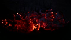 Burning charcoal in the dark Stock Footage
