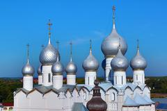 Domes of assumption cathedral and church of resurrection in rostov kremlin Stock Photos