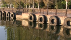 Abandoned river pier with big tires in the water Stock Footage