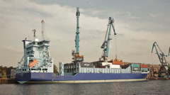Latvian container ship loading containers by cranes Stock Footage