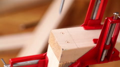 Carpenter connecting wood planks with electric screwdriver Stock Footage