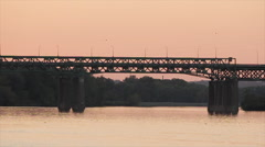 Cars drive across a busy bridge on the Mississippi - stock footage