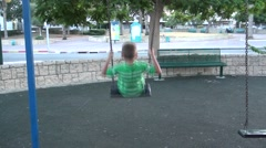 A boy goes for a drive on a swing Stock Footage