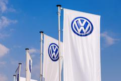 The flags of volkswagen over blue sky Stock Photos