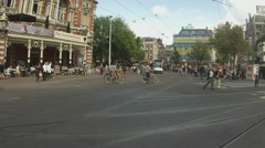 Trams come and go on Leidseplein Stock Footage