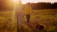 Children with dog walking in nature in the evening, peaceful, trust Stock Footage