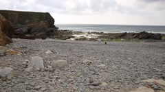 Shingle and pebble beach Gunwalloe Cornwall England UK Stock Footage