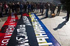 Police chief Viktor Biryukov checks posters opposition peace March Stock Photos