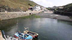View to Mullion Cove from harbour wall Cornwall UK Stock Footage