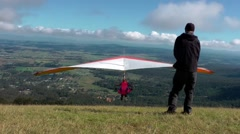 Hang gliders take off from a mountain top Stock Footage
