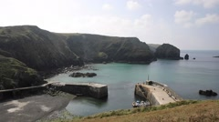 Elevated view of Mullion Cove the Lizard Cornwall UK Stock Footage