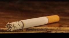 Long cigarette smolders. Tobacco, Smoking, cigarette Stock Footage