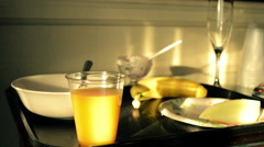 Breakfast plate in the morning sun, hotel visit, juice and fruit Stock Footage