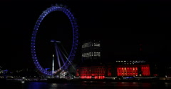 UHD 4K Illuminated Night Lights Red Blue Color Landmarks London Eye Thames River Stock Footage