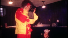1179 - clown performs at birthday magic show - box - vintage film home movie Stock Footage