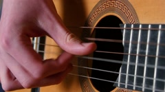 Strumming Playing Acoustic Guitar - stock footage