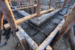 construction house, reinforcement metal framework for concrete pouring - stock photo